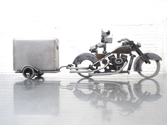 4 Piece Metal Sculpture; A dog, a Harley, a trailer, and a fuel tank