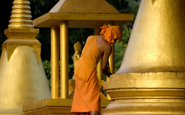 Buddhist monk cleaning Lamai Temple. By Marina Nozyer