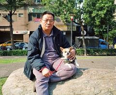 Big Man and Small Dog (both wearing rather fetching outfits) (deepstoat) Tags: dog colour 120 film mediumformat outfit taiwan tiny roll mamiya7ii kodakportra thelittledoglaughed deepstoat