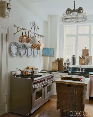 Vintage mix in the kitchen: Copper pots + antique French cutting boards, from Elle Decor