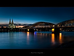 ".. . Blue Hour Cityscape . .. (tommatsch (New Gallerys""Noisy & EOS"")) Tags: lighting longexposure blue light sunset sky water architecture train river germany lights evening nikon exposure cityscape colours sonnenuntergang cathedral dom cologne zug kln architektur bluehour nikkor rhein deutz riverrhine klle d90 hohenzollernbrcke magicallight hohenzollernbridge mywinners abigfave nikond90 1685mm artofimages tommatsch bestcapturesaoi viewfromklndeutz"