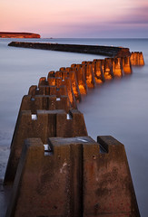 Arbroath Barrier (ajnabeee) Tags: ocean lighting longexposure blue light sunset red sea sky orange seagulls seascape motion blur colour eye water wall graffiti scotland high waves harbour angus dusk path tide horizon scottish cliffs follow line filter blocks lead defense arbroath defence stacks leadin 10stop nd1000 nd10 shahbazmajeed