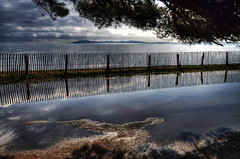 Hyres Plage 1 (marcovdz) Tags: sea mer france reflection beach clouds fence puddle reflet provence nuages plage var hdr picket flaque clture 3xp hyres ayguade