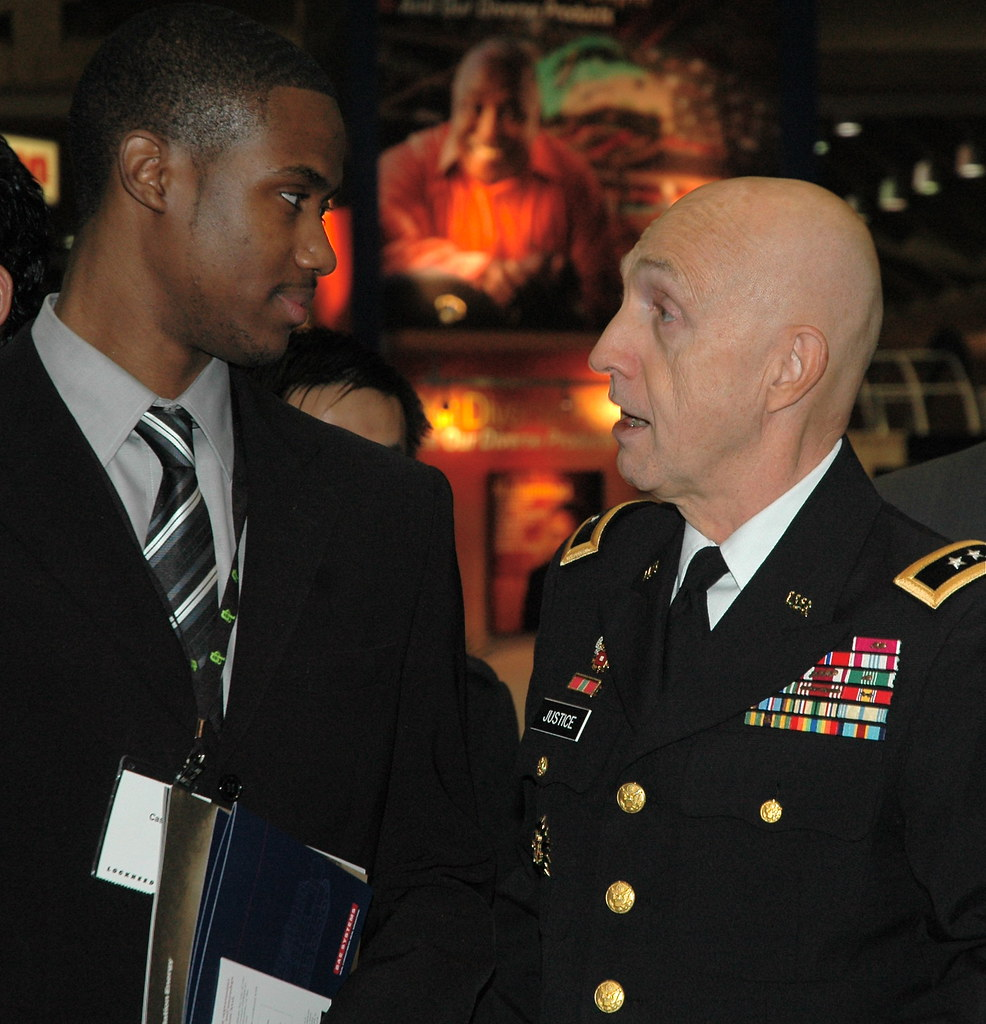 RDECOM Commander Maj. Gen. Nicholas talks to an engineering student about opportunities for civilian service in the Army.