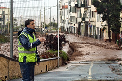 Madeira Storm: Safety First (Mr.Enjoy) Tags: city people storm man streets portugal nature water rain weather river island am flooding force control mud natural flood flash over fast police safety drain clear help aid disaster damage curious roads madeira tempo current floods policia ribeira temporal funchal torrent soaked tempestade madeirai