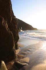 Looking towards the arch (Cyclingrelf) Tags: sea coast sand cornwall surf arch bluesky cliffs backlighting nanjizal