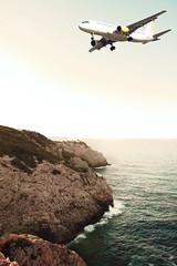 In the Air (Luis Hernandez - D2k6.es) Tags: road trip blue light summer sky costa luz sol beach water azul skyline canon airplane spain agua air playa cielo verano mallorca avin naranja islas rocas avion baleares hollidays degradado vacationes balear 50d