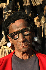 Konyak headhunter in the village of Chi, Nagaland (sensaos) Tags: portrait people india face tattoo sisters glasses asia retrato north tribal portrt east seven portret northeast ritratto facial portre indigenous azie noord oost headhunter azi tattooed konyak