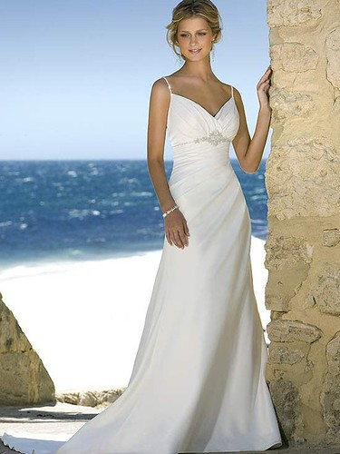 Gown features beaded straps and decorative brooch.