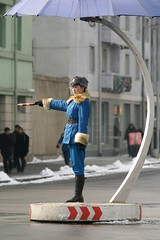 Traffic policewoman near Taedong Bridge, Pyongyang (Moravius) Tags: winter pyongyang dprk  trafficpolicewoman