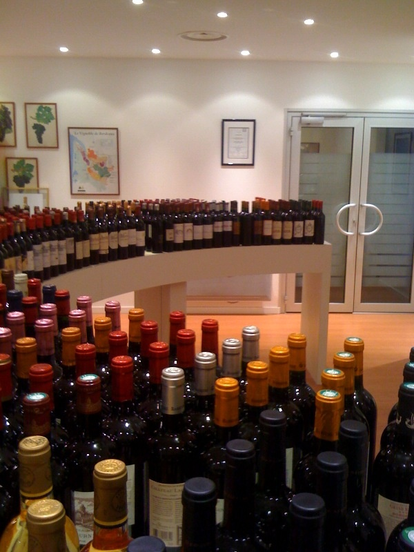 Bottles arranged for negociant tasting.