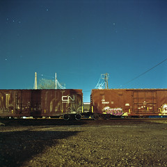 RR (patrickjoust) Tags: road street city railroad urban usa color 6x6 tlr film night analog america dark square lens us reflex md focus long exposure fuji mechanical telephone united release tripod patrick twin maryland rail cable baltimore pole mat v 124g infrastructure pro epson after medium format boxcar states manual 500 expired joust yashica gravel 220 estados 80mm f35 fujicolor c41 unidos yashinon v500 160s autaut patrickjoust