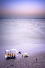 In a Bottle (Khaled A.K) Tags: blue sunset sea seascape water landscape bottle ship bottles small large land sa jeddah scape saudiarabia khaled waterscape ksa saudia kashgari kashkari