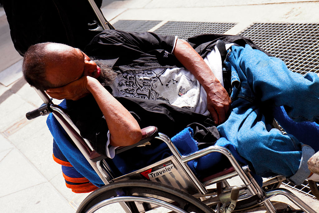 Man-sleeping-on-wheelchair--Center-City