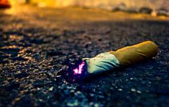 Slow death... (Jay-tography) Tags: street blue macro azul calle purple floor cigar amarillo violeta lus piso cigarrillo yellos