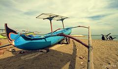 bali boat (izamree) Tags: travel sky bali beach canon indonesia landscape sand tonne kuta balinese izamree