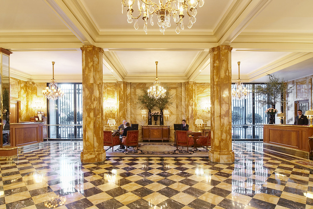 Sumptuous and luxury lobby with checkered black and white polish floor at The Hôtel de Crillon, Paris, France.