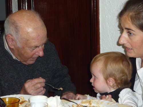 Great-grandfather feeds Nora cake icing
