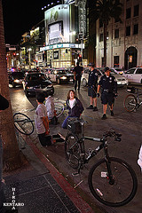 The Cyclists (5 of 8) (razorcutgarlic) Tags: life california street city people urban white black streets bike bicycle cyclists losangeles hands uniform gun cyclist cops force candid police bikes bicycles badge cycle hollywood criticalmass cop guns law enforcement excessive mass critical officer handcuffs blvd arrested arrest holster policeman policemen lapd officers handcuff uniformed handcuffed detained detain detainment misconduct