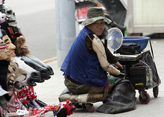 A Living (Dapper snapper) Tags: life street canon hand mask hard korea beggar help thoughts seoul disabled latex karaoke cart eos1d prosthesis amputee prosthetic itaewon legless ef70200f28l limbless mkiin