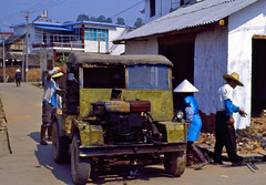 Chinese Truck (polarapfel) Tags: china street travel industry film analog rural truck construction day technology village minolta outdoor chinese documentary international dai transportation remote yunnan adults minority xd7 eb banna manufacturing xishuangbanna 35mmtransparency kodakprofessionalelitechrome100 md50mmf12