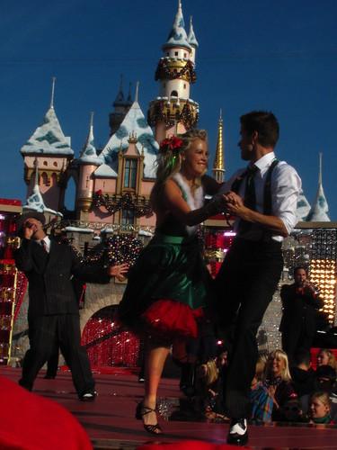 Chelsie Hightower and Louis Van Amstel perform in front of Sleeping Beauty Castle