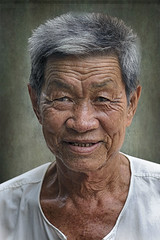 Portrait Of An Old Gray-Haired Thai Man (ulli_p) Tags: asia art artofimages aworkofart awardtree canoneoskissx5 colours earthasia flickraward head isan man portraits people ruralthailand thailand