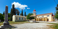 All Saints Orthodox Church and School at Gouvia Kerkyra. (clive_metcalfe) Tags: church school gouvia corfu greek island kerkyra allsaints orthodox greece belltower windows flags clouds