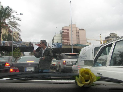 man selling lottery tickets in traffic jam