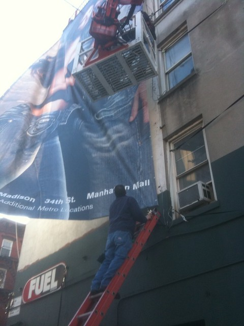 dudes putting up a billboard #walkingtoworktoday