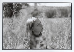 Hide in the Tall Grass (Ludovic Macioszczyk Photography) Tags: world life camera light 2 portrait people  6 white 3 black france art love film girl monochrome grass analog 35mm canon vintage hair photography 50mm 1 photo exposure shoot noir photographie dof natural sweet ae1 5 no flash 4 tamara grain picture 7 8 9 scan iso hide photographs 400 keep tall alive 135 sweetheart 18 et fille blanc ilford 2009 tam 87 argentique limousin fd photographe cheveux ludovic ngatif pellicule ludos dveloppement macioszczyk
