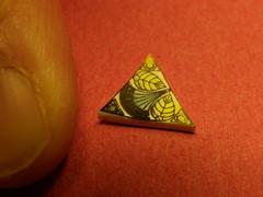 One Triangle and Thumb (sugarpacketchad) Tags: macro triangle pattern close thumb orangebackground