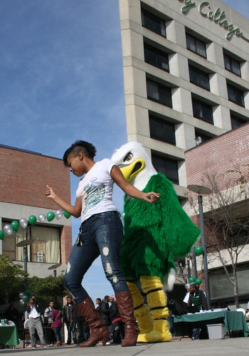 Eddie the Eagle and Laney College student Ebony Miller shake a tail feather at the Welcome Back Bash January 28, 2010