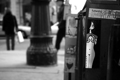 the only way for her to overcome her innate sadness was to be a public exhibitionist... (damonabnormal) Tags: street city urban blackandwhite bw streetart philadelphia canon nude graffiti sticker stickerart breasts stickers january streetphotography urbanart pa philly nudity phl 2010 215 radius citystickers streetstickers 40d
