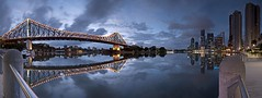 Brisbane & the bridge: a panorama from the Brisbane Riverside Walkway (noompty) Tags: city bridge water ferry clouds sunrise reflections river geotagged pentax australia wideangle brisbane queensland reflexions brisbaneriver storybridge cloudscapes k7 sigma1020mmf456 justpentax reflectyourworld pentaxart pentaxk7