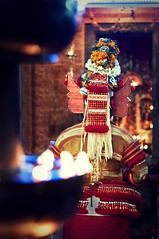 Muthappan Theyyam (christian.senger) Tags: travel light red people india man yellow night digital geotagged temple gold nikon worship asia dof bokeh availablelight religion kerala hinduism lightroom d300 theyyam kannur muthappan christian_senger:year=2010