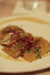chestnut ravioli with bacon and cress