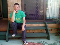 25/02/2010 (Day 4.56) - On The Back Step (Kaptain Kobold) Tags: china old blue selfportrait green alan wooden tshirt deck step converse 365 timer dinosaurs backdoor selfie kaptainkobold trp 365days p365 365year4