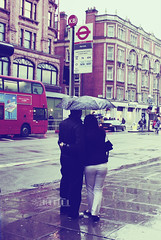 Lovers In Rain.. (- M7D . S h R a T y) Tags: street uk people london cars love buses rain umbrella harrods lover rainyweather wordsbyme allrightsreserved