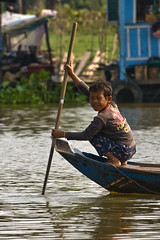 Boy on the river (tatlmt) Tags: river boats boat cambodia floatingvillages