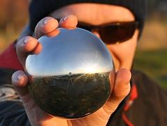 A self portrait of my camera at sunset (Greg 50) Tags: sunset selfportrait reflection metal self globe steel orb d90 digitalcameraclub goury