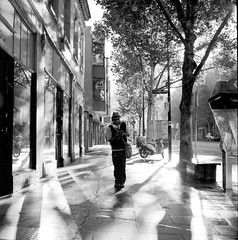 (supacrush) Tags: morning light tree film hat reflections haze vespa shadows y phonebooth melbourne scooter smoking telstra rodinal150 2010 hasselblad500cm reflectedlight zeissplanar80mmf28 explorefrontpage fujineopanacross100 museumofdirt melbournelight