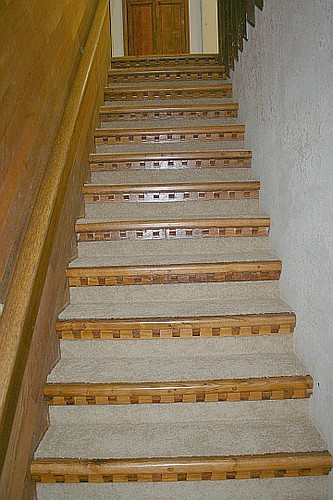 Carpeted stair with bull nosed oak & corbel style dentils