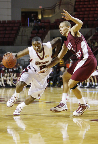 February 14, 2010 - Ricky Harris of the UMass Minutemen scored the most points against the Hawks in the UMass home game tonight in Amherst. Hawk's Garrett Williamson is attempting to block him.