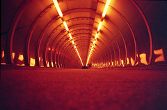 Poplar Tunnel, redscale (slimmer_jimmer) Tags: london poplar footbridge tube tunnel docklands canarywharf dlr foottunnel poplardlrstation redscale cosina20mmf38 redscaledfujisuperior400