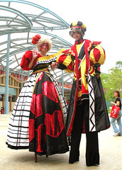 Towering Royalty (Nikita Hengbok) Tags: costumes performers stiltwalkers entertainers stiltwalking rws performingart queenofheart resortworldsentosa singaporefemalestiltwalker singaporegirlstiltwalker singaporestiltwalkers stiltwalkerteam stiltwalkertroupe stiltwalkersatevents stiltwalkercostumes stiltwalkingcostumes