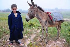 foggy afternoon in the Atlas (luca.gargano) Tags: africa child donkey morocco maroc atlas marocco maghreb raincoat gargano morokko onephotoweeklycontest lucagargano