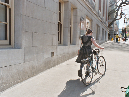 bicyclist with tattoos and black dress, central library