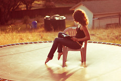 (emily golitzin) Tags: selfportrait girl myself reading book chair trampoline woo explore canonef50mmf18ii canoneosdigitalrebelxsi manualfocuswin