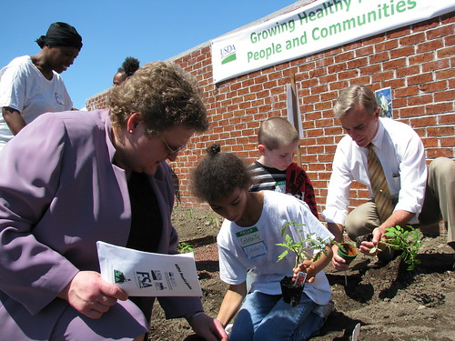 USDA Rural Development Deputy Under Secretary Cheryl Cook assists Celebrity Harmon.  Dylan Caldwell gets assistance from USDA Rural Development State Director Jack Tarburton.